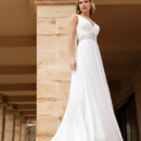 Destination Romance STYLE DR206 Chiffon, A-line gown with a V-neckline and ruched bodice with beaded embellishment on waist. Skirt features a Chapel length train.