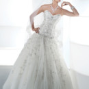 Ilissa Style No. 534 Strapless, jewel encrusted, beaded tulle wedding gown with a sweetheart neckline, drop waist and corset basic. Bridal dress features an attached sweep train.