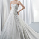 Ilissa Style No. 538 Strapless tulle A-line wedding gown featuring soft pleating and a corset back. The beaded bodice is embellished with Swarovski crystal jeweling. This bridal dress is finished with an attached train.