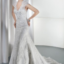 Ultra Sophisticates 1449 This bridal gown is a Lace Sheath with a V-neckline and sheer lace top with a high keyhole. An attached train finishes off this wedding dress.