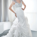 Illusions Style 3184 Organza sleeveless, fit and flare bridal gown with a V-neckline, asymmetrical ruching and bustled skirt. The empire bodice on this wedding dress is embellished with beads and jeweling and features a keyhole back finished with lace-up.