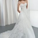 Illusions Style 3185 Satin organza, strapless wedding gown with a sweetheart neckline and wrap bodice with asymmetrical ruching. The A-line skirt on this bridal dress features side draping with beaded applique embellished with Swarovski crystals and an attached train.