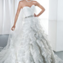 Illusions Style 3195 Satin organza, strapless wedding gown with a sweetheart neckline, ruched wrap bodice and attached jeweled belt. The A-line skirt on this bridal dress features layers of ruffles and flowers continuing throughout the attached train.