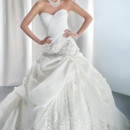 4313 Satin organza, strapless wedding gown with an asymmetrical ruched bodice with flowers and corset back. This bridal dress has a full bustled skirt features pick-up with lace and tulle underlay and attached train.