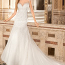 575 This sleeveless, beaded tulle, modified a-line gown with Sweetheart neckline features a high illusion neck accented with jeweled embroidery. The dramatic sheer illusion back features a button closure and chapel train.