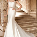 3228 This sophisticated mikado gown features a soft sweetheart neckline with sheer jeweled cap sleeves, a plunging back and semi-chapel train. Belt sold separately.
