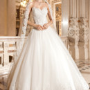 4329 This traditional, strapless, tulle ball gown features a sweetheart neckline and basque waist. The bodice and hem of skirt are embellished with venise lace. The back is finished with a lace-up closure and features a magnificent multi-tiered removable cathedral length train.