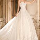 4330 This strapless organza ball gown features a lace bodice with sweetheart neckline, full skirt with scattered lace appliques and magnificent scalloped hemlace that continues into the lavish, removable cathedral length train.