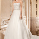 262 This elegant soft tulle strapless ball gown features beaded embroidery on the bodice and attached beaded belt with crystal accents on the waist. The tulle skirt flows into a chapel length train.