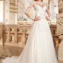 269 This timeless soft tulle a-line gown features delicate venise lace on the sweetheart neck bodice and satin ribbon with bow on waist. Delicate lace accentuates the sheer neckline and sleeves and flows into the plunging low back.