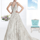 1466 Beaded lace, Halter wedding gown with a low back and full A-line skirt. This bridal dress features a Chapel length train.