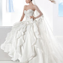 3200 Strapless, Satin Organza wedding dress with a beaded lace bodice and Sweetheart neckline. The full A-line skirt on this bridal gown features tiers of ruffles and attached Chapel train.