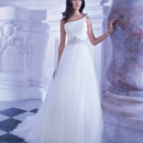 248 Soft Tulle, One-shoulder A-line wedding gown with attached jewel-encrusted belt. This bridal dress has a Chapel train.