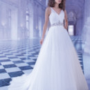 250 Soft Tulle, sleeveless, A-line wedding gown with a V-neckline and attached jewel encrusted belt. Te back on this bridal dress features buttons over zipper and attached Chapel train.