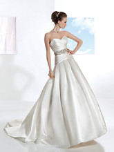 Illusions Style 3203 Crystal Organza, A-line wedding gown with a Sweetheart neckline, asymmetrical pleating on bodice with buttons on back and attached jeweled belt. The skirt on this bridal dress features box pleats and attached Chapel length train.
