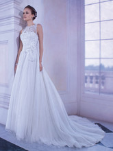 Sensualle Style No. gr255 Sleeveless, Soft tulle, flowing A-line wedding gown with a lace bodice, high, sheer lace neckline and flowers at waist. The high, sheer lace back on this bridal dress features buttons and attached Chapel train.