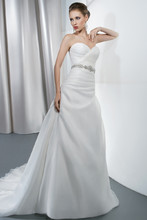 Illusions Style 3191 Satin organza, strapless wedding gown with a sweetheart neckline and corset back. The bodice on this bridal dress features asymmetrical ruching and attached beaded belt. A-line skirt features an attached train.