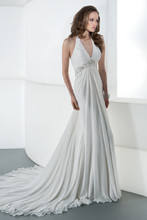 DR178 Chiffon V-neck, halter bridal dress with ruching and corset back. Empire waist is adorned with a beaded belt embellished with crystal jeweling. Draped skirt features and attached train. Perfect look for a destination wedding.