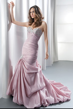GR227 Strapless, taffeta, ruched, fit and flare with a corset back and beaded embroidery on empire bodice. Bustled skirt features pick-ups with beaded appliques, a bubble hem and attached train. Available in ivory, white, pink, gold, purple, platinum, grey-blue.