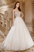567 This dreamy ball gown features a sweetheart neckline with a jewel- encrusted bodice, low v-back and chapel train.