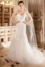 587 This modified a-line gown features magnificent beaded vine embroidery over tulle that cascades from the bodice into the skirt. The low back features a chapel train.