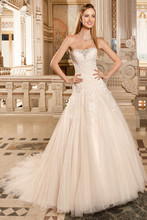 1480 This strapless, romantic, gown features a dropped waist and decadent crystal beading on the neckline. The bodice is adorned with delicate lace that cascades into the tulle a-line skirt with chapel train.