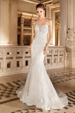 1481 This sultry strapless, form -fitting gown with soft sweetheart neckline and illusion insert is adorned with embroidered lace and accents of delicate beading on the bodice. The back features a lace-up closure and sweep train.