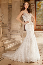 1491 This magnificent fit n flare gown features richly embellished appliques over chantilly lace, a v-neckline, lace spaghetti straps flowing into a sheer back with button closure and a chapel train.