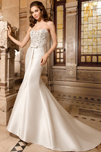 3211 Elegant, strapless, form fitting, mikado gown with sweetheart neckline and beaded pearl embroidery with jewel accents on bodice. Waist is finished with beaded trim and bow. The back features a button closure.