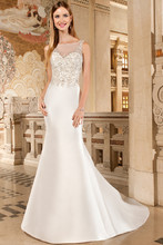 3213 Chic, sleeveless, mikado, form fitting gown features a magnificent sheer beaded bodice over a sweetheart neckline and sheer beaded low v-back with button closure. Back is finished with chapel train.