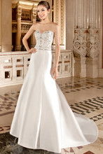 3215 This elegant, mikado, strapless, modified a-line gown with a sweetheart neckline features beaded embroidery with clusters of jeweling on the bodice and beaded trim on the natural waist. The back features a button closure with buttons cascading down entire skirt into chapel train.