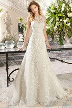 212 This timeless, a-line, gown features delicate embroidered lace with a sweetheart silhouette and illusion lace overly creating a bateau neckline. The illusion lace back features a button closure.
