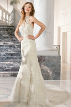 215 This beaded lace halter gown features a high beaded illusion neckline with key-hole cut-out and plunging low back with chapel train.