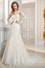 217 This classic all lace, a-line gown features a high illusion neckline and long sheer sleeves with lace appliques. The keyhole illusion back features a delicate scalloped lace edging with button closure and chapel train.