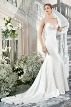 218 This sophisticated, luxe satin, form fitting gown with a jeweled sweetheart neckline features sheer, beaded straps transitioning into a magnificent illusion back embellished with crystal beaded embroidery and button closure.