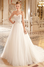 260 This flowing soft tulle strapless ball gown features a sweetheart neckline and delicate beaded lace on the bodice. The back features a lace-up closure and chapel length train.