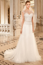 265 This soft tulle a-line gown features a sweetheart bodice with a beaded tulle overlay, sheer beaded neckline and low sheer beaded back. Delicate beaded trim accentuates the waist.