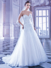 547 Beaded Tulle, Strapless A-line wedding gown with a Sweetheart neckline and lace-up back. This bridal dress features an attached Chapel Train.