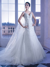 559 Beaded organza A-line wedding dress with a sweetheart neckline embellished with jewels, sheer beaded straps and plunging back. This bridal dress features a Chapel train.