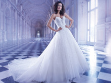 561 Jewel encrusted beaded tulle ball gown wedding dress with a V-neckline and spaghetti straps. Bridal gown features a lace-up back and attached Chapel train.