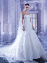 562 Strapless, Beaded Tulle A-line wedding dress with buttons over zipper. This bridal gown has an attached Chapel train.