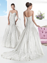 1452 Venice lace over Tulle, strapless, fit n flare wedding gown with a Sweetheart neckline and buttons on back. This bridal dress features an attached Chapel train. Jeweled belt sold separately.