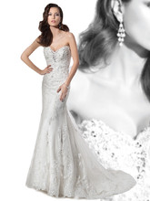 1455 Beaded Venice lace fit n flare, strapless wedding gown with a Sweetheart neckline and buttons on back. This bridal dress features an attached Chapel train. Beaded belt sold separately.