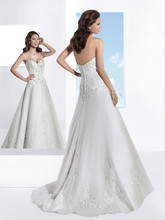1456 Strapless, Organza wedding gown with a Sweetheart neckline and A-line skirt. The bodice and skirt on this bridal dress are embellished with beaded Venice appliqués. Back is finished with buttons over zipper and attached Chapel length train.