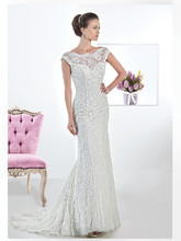 1457 Chantilly lace sheath wedding gown with a sheer lace neckline and low V-back. This bridal dress features a removable satin belt and Chapel length train.