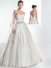 1458 Strapless, lace over tulle wedding gown with a full A-line skirt and jeweled belt. The back on this bridal dress features buttons over zipper and attached Chapel length train.