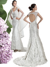 1460 Venice lace wedding gown with a V-neckline, dramatic key-hole back and Trumpet skirt. The back on this bridal dress features buttons over zipper and attached Chapel length train. Jeweled belt sold separately.