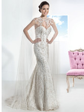 1461 Strapless, beaded lace wedding gown with a Sweetheart neckline and lace-up back. This bridal dress features a Trumpet skirt and Chapel length train. Cape sold separately.