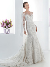 1468 Beaded lace, fit and flare wedding gown with a high sheer neckline and long sheer lace sleeves. This bridal dress also features a low sheer back with buttons and Chapel length train.