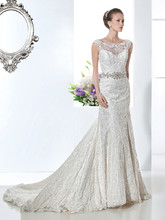 1472 Beaded Venice lace, A-line wedding gown with a sheer lace neckline and low V-back. This bridal dress features a Chapel length train. Jeweled belt style BL37 sold separately.